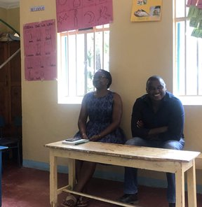 Photo of Fredrick Mutinda, Project Director, and Lillian Onyango, Advocacy Manager, Changing the Way We Care, sitting at a table in Nyamira, Kenya